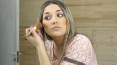 Girl looking in the mirror and applying cosmetic Stock Footage
