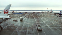 Airport traffic: landing airplanes, waiting for takeoff Stock Footage