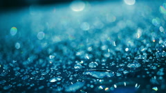 Water drops on glass after rain. Water droplets on glass in blue color Stock Footage