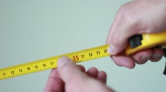 Holding a yellow centimeter Stock Footage