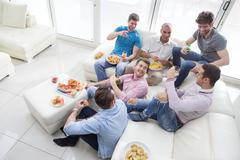 Men Enjoying Pizza And Beer - stock photo