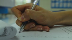 Woman's Hand Neatly Complete a Form. Woman Writes With a Pen. Closeup Stock Footage