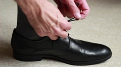 Man putting shoes on Stock Footage