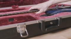 Man's hands take beautiful blue electric guitar out of a case. Ibanez JS1000 Stock Footage