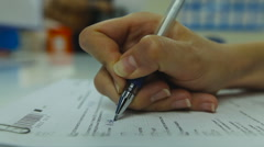 View of Woman's Hand Neatly Complete a Form Print. Woman Writes With a Pen. Stock Footage