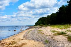 Bright cloudy sky and horizon over the Baltic Sea. Latvia - stock photo