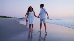 Happy Spanish children enjoying time with parents on beach at sunrise Stock Footage