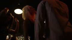 4K Low angle view of young party crowd dancing & having fun in nightclub Stock Footage