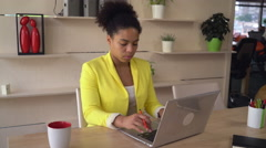 Mixed race woman works in office international company Stock Footage
