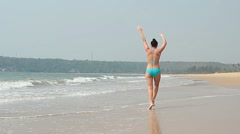 Beauty woman relaxing on the Goa beach Stock Footage