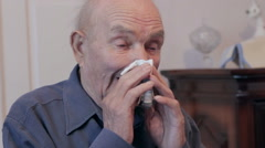 Old man wiping his nose with a handkerchief Stock Footage