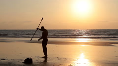Unidentified man spinning pole on the beach Stock Footage