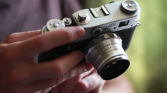 Man opens an old russian photo camera and shows it's back Stock Footage