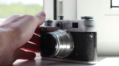 Man demonstrates the vintage russian photo camera - stock footage