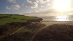 Aerial view of a cornwall's beach and coastline at sunset Stock Footage