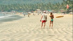 Unidentified people relaxing on the Palolem beach. Stock Footage