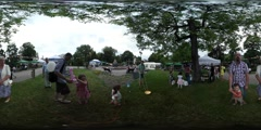 360Vr Video Kids Playing on a Grass City Day Opole Square Tents Chairs Tables Stock Footage