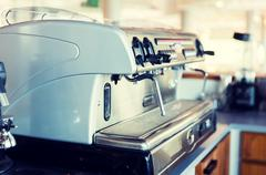close up of coffee machine at bar or restaurant - stock photo