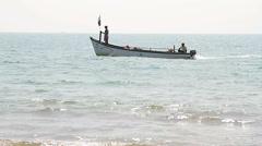 Fisherman boat  on the Palolem beach Stock Footage