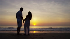 Sunset silhouette of Spanish family enjoying the beach Stock Footage