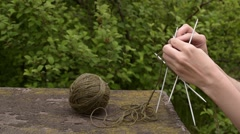 Knitting in the garden Stock Footage