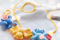 Close up of baby rattle and bib for newborn Stock Photos