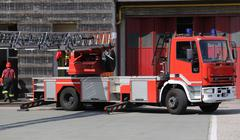 Fire engine truck during a fire drill in the fire brigade station Kuvituskuvat