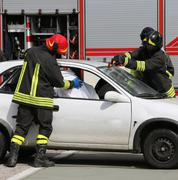 Firefighters in action after the road accident Stock Photos