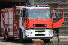 Fire engine truck during an exercise in fire brigade station Kuvituskuvat