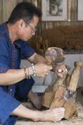 The artisan carving wooden sculpture elephant figurine Stock Photos