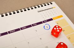 Blue Circle marked on Calendar with Red Dice Stock Photos
