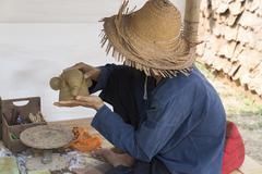Man molding elephant clay figurine Stock Photos