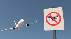 Airliner and a no drone zone sign Stock Footage