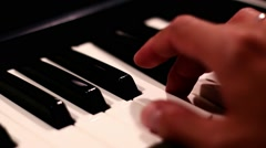 Hands Playing Piano Low Angle - stock footage