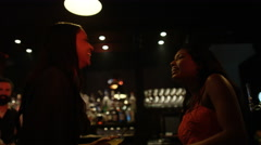 4K Friendly barman serving shots to female friends in nightclub Stock Footage