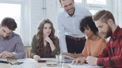 Group of casual business people during training with coach Stock Footage