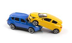 Car accident concept, two toy cars isolated on white Stock Photos