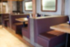 Cafe coffee shop restaurant interior, blur and defocus Stock Photos