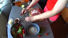 Female hands cook pulled pork on kitchen: put herbs on peace of fat meat Stock Footage