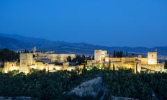 Ancient arabic fortress of Alhambra at sunset. Granada, Spain. Stock Photos