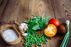 Basil, color tomatoes, garlic, green peas, salt and onion - stock photo