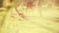 Local kids playing football in the village. Slow motion - stock footage