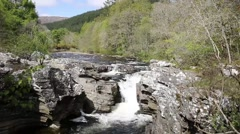 River Moriston falls Invermoriston bridge Scotland UK tourist destination Stock Footage