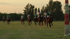 Polo challenge during sunset. Jockeys chasing the ball. Slight slow motion. N Stock Footage