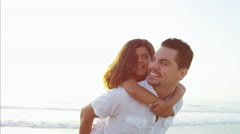 Smiling Spanish girl enjoying time with father on Summer beach Stock Footage