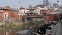Ceremony with hindu priest at Pashupatinath,Kathmandu,Nepal - stock footage