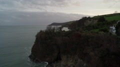 Aerial view of Fowey coastline at sunset in the South West Coast of England Stock Footage