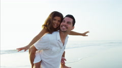 Portrait of Latin American girl enjoying time with father on Summer beach Stock Footage