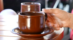 Woman drinks coffee. Cup close-up - stock footage