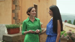 Two Attractive Young Women in Light Summer Dresses Have Conversation on Street - stock footage